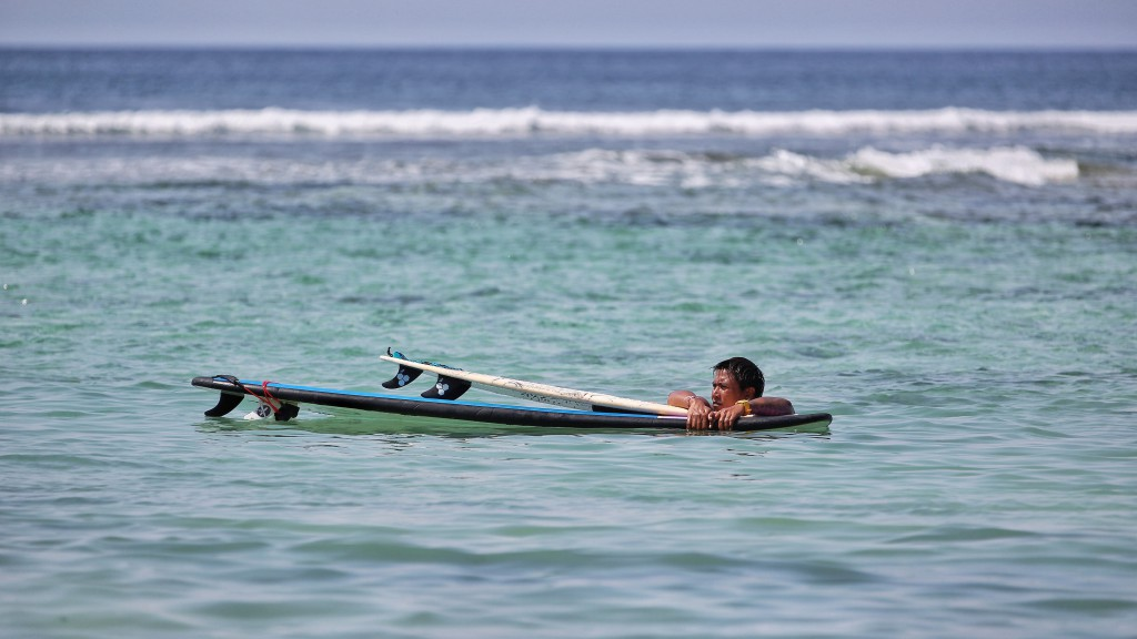 surfer on uluwatu beach