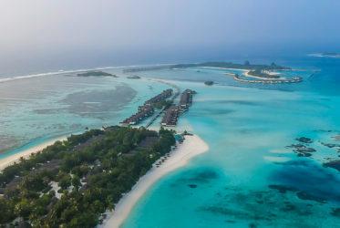 Kuda Huraa widok na water villas i Reef Club