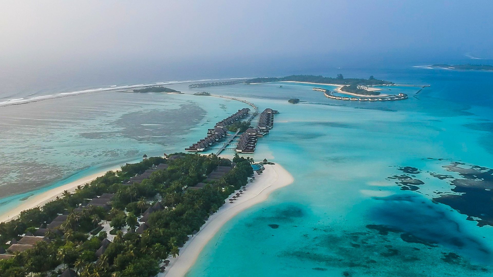 Kuda Huraa widok na water villas i Reef Club